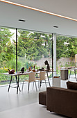 Table on trestles next to glass wall in architect-designed house
