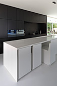 Chairs fitting flush under counter in modern, open-plan ktichen