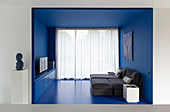 Chaise easy chairs in small living area in blue alcove