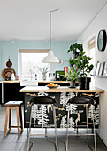 Bar stools at kitchen counter in modern kitchen-dining room