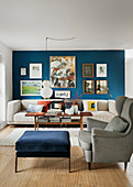Gallery of pictures on blue wall in classic living room