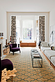 Graphic patterns on rug and curtains in elegant living room