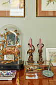 Kitsch, gilt, vintage-style arrangement with flamingo-shaped candlesticks