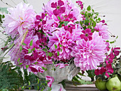 Arrangement with dahlias, clematis and barley