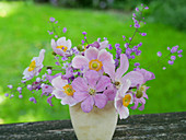 Bouquet of autumn anemone, clematis 'Comtesse de Bouchaud' and gypsophila