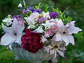 Early summer bouquet with peony, clematis 'Omoshiro', columbine and ornamental onion