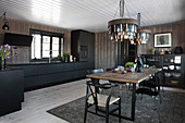Open-plan kitchen-dining room in modern wooden house