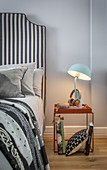 Double bed with tall headboard and Nordic-style bedside table