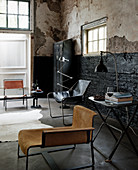 Industrial-style living room: various chairs, console table and locker