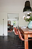 Wooden dining table, classic chairs and pendant lamp