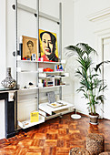 Potted palm and shelves in period apartment