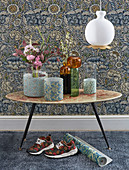 Vases with covers made from floral paper in front of vintage-style floral wallpaper