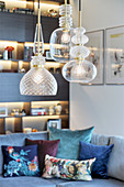 Ceiling lamps made from various types of glass in elegant living room