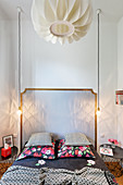 Double bed, pendant lights and bedside tables