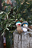 Knitted winter decorations in shapes of snowman and reindeer