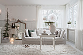Christmas decorations in classic, white living room