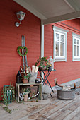 Rustic winter decorations on roofed terrace of Swedish house