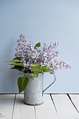 Bouquet of lilac in zinc jug