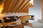 Chesterfield sofa and fireplace in rustic living room
