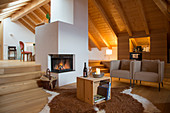 Modern armchairs and fireplace in rustic living room