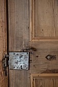 Antique, wooden panelled door with old fittings