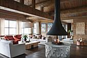 Open fireplace in living room of elegant log cabin