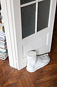Plaster foot used as door stopper