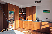 Fitted kitchen with wooden fronts