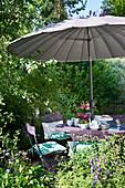 Secluded spot below parasol in garden