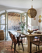 Lampshade above dining table with view onto terrace