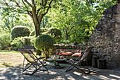 Deckchairs and table on shady terrace