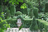 Box trees around lion waterspout in formal garden in Jardin Agapanthe, Normandy, France