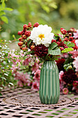 Bouquet of dahlias and unripe blackberries