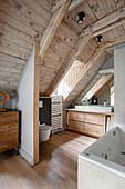 Ensuite attic bathroom with wood panelling on ceiling