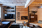 TV, fireplace with wood panelling and cabinet in living room