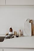 Kitchen utensils on white worksurface