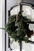 Handmade wreath of fir branches on door
