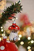 Christmas-tree decoration in shape of fly agaric mushroom and sparkling lights