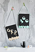 Handmade Halloween flags made from construction paper and googly eyes