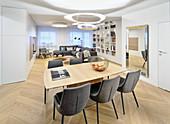Modern, open-plan interior in masculine designer style