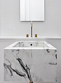 Cubic marble sink in white minimalist bathroom