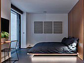 Floating bed in minimalist bedroom