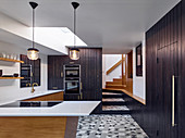 Retro kitchen with black board fronts and patterned floor tiles
