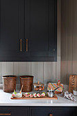 Dark kitchen cabinets with quartz worksurface
