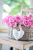 Gift basket with roses, heart and 'Good Luck' pendant