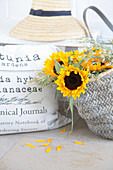 Sunflowers and grasses in shopping bag