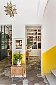 Baroque wooden cabinet next doorway leading into living space