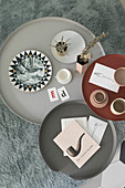 Bird's-eye view of vintage-style accessories on three round coffee tables