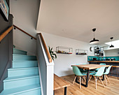 Staircase with pale blue steps in modern, open-plan interior