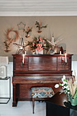 Piano surrounded by Christmas decorations